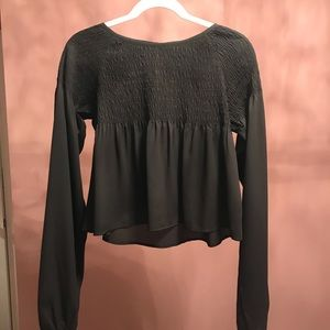 Black long sleeve top with ruching detail